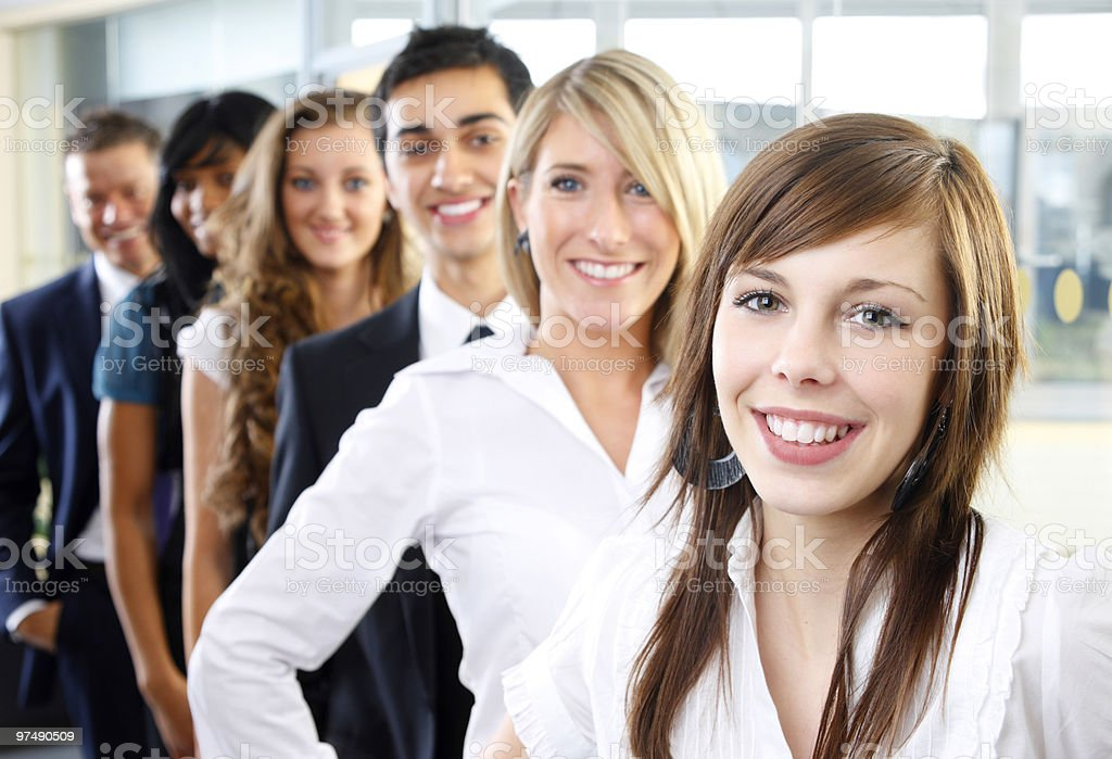 close-up of young happy Interracial business team standing in line royalty-free stock photo