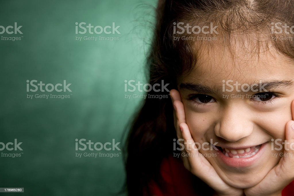 Closeup of Young Hispanic School Girl Giggling royalty-free stock photo