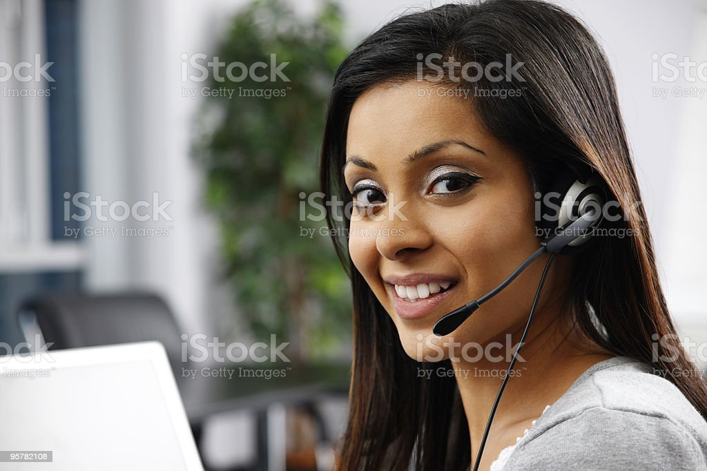 close-up of young Indian customer service operator in modern office royalty-free stock photo