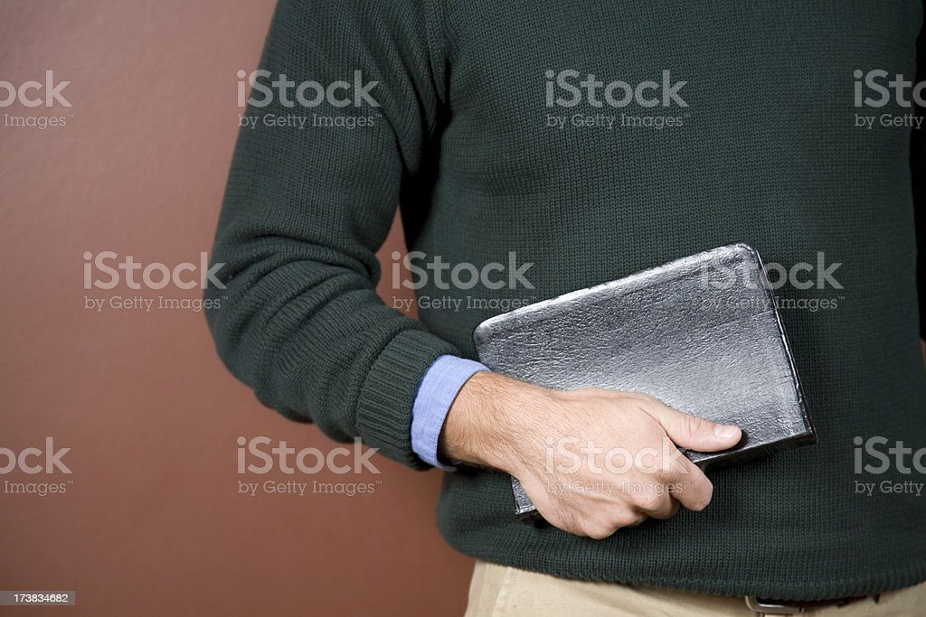 Closeup of Young Man Holding Bible With Copy Space stock photo