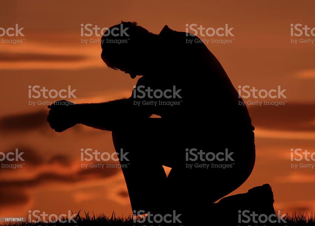 Closeup of Young Man Praying Outside royalty-free stock photo