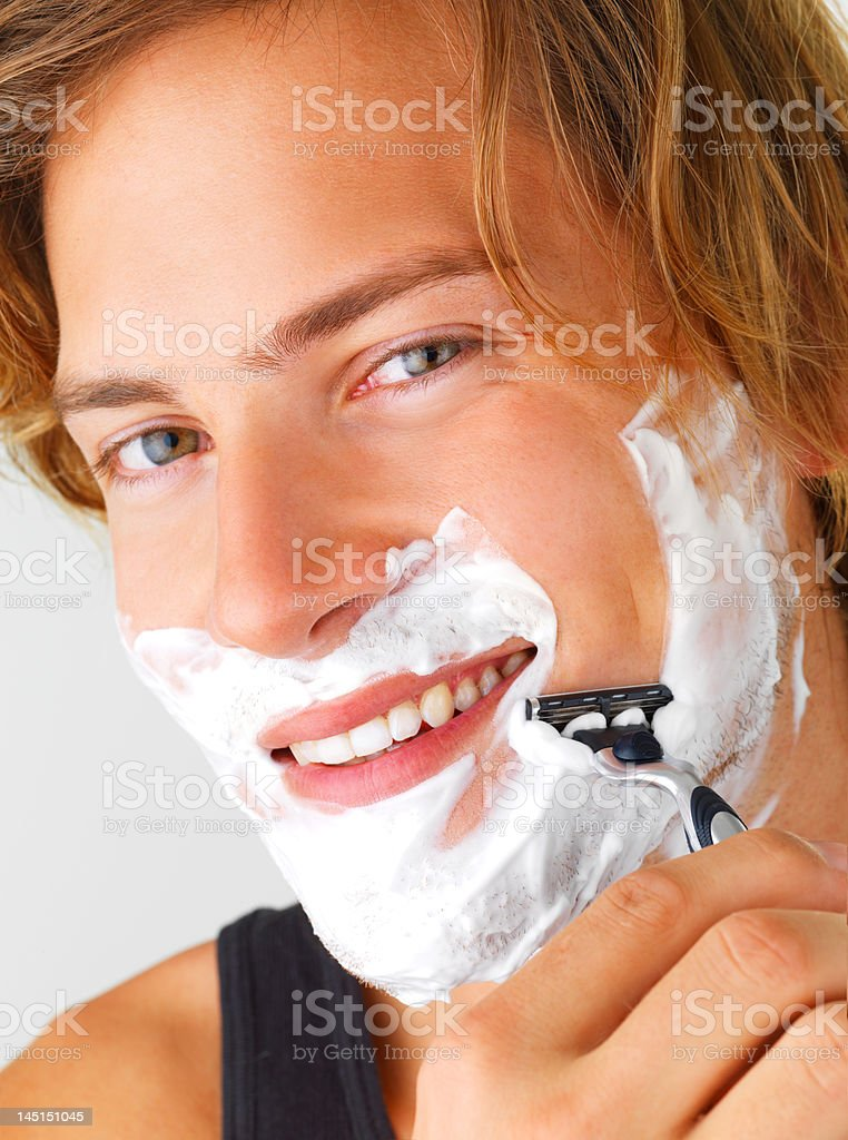Close-up of young man shaving royalty-free stock photo