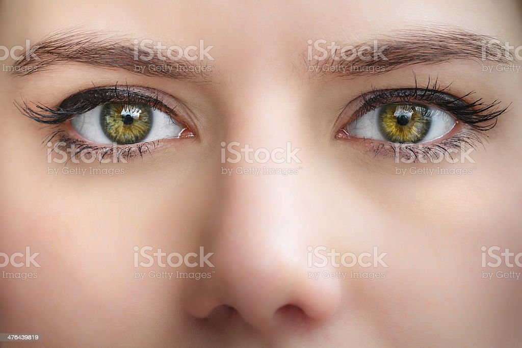 Close-up of young woman green eyes stock photo
