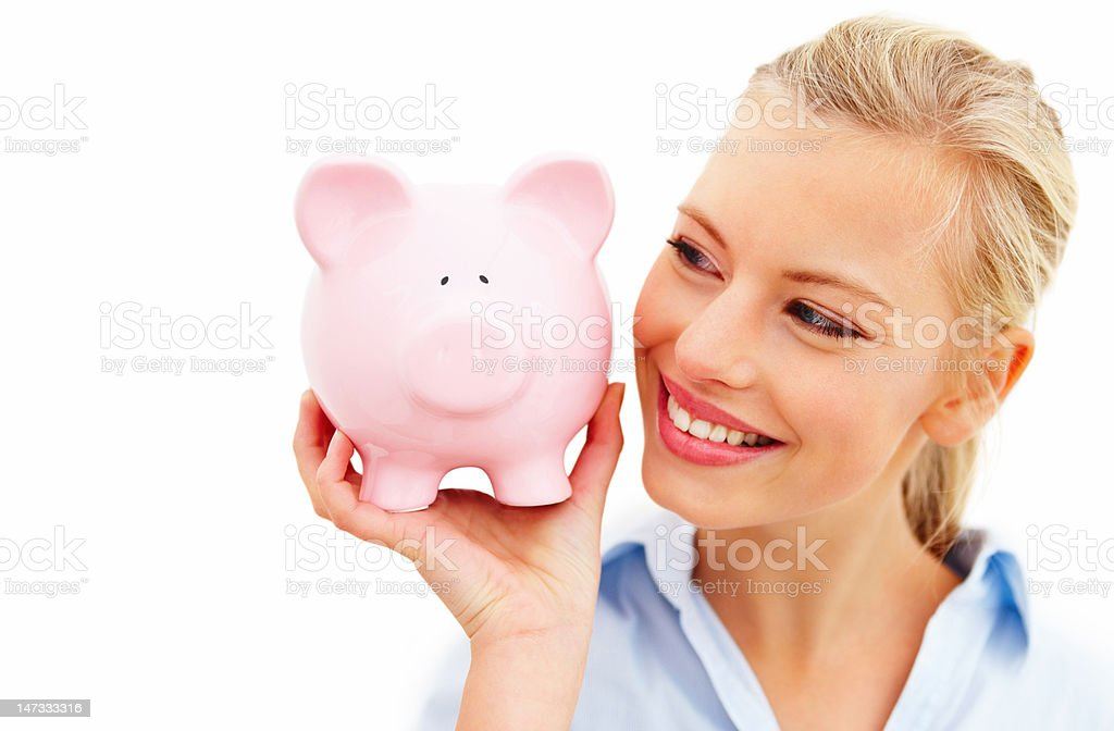 Close-up of young woman holding piggy bank against white background royalty-free stock photo