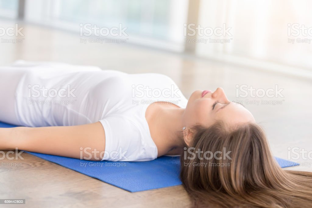 Closeup of young woman in Dead Body pose stock photo
