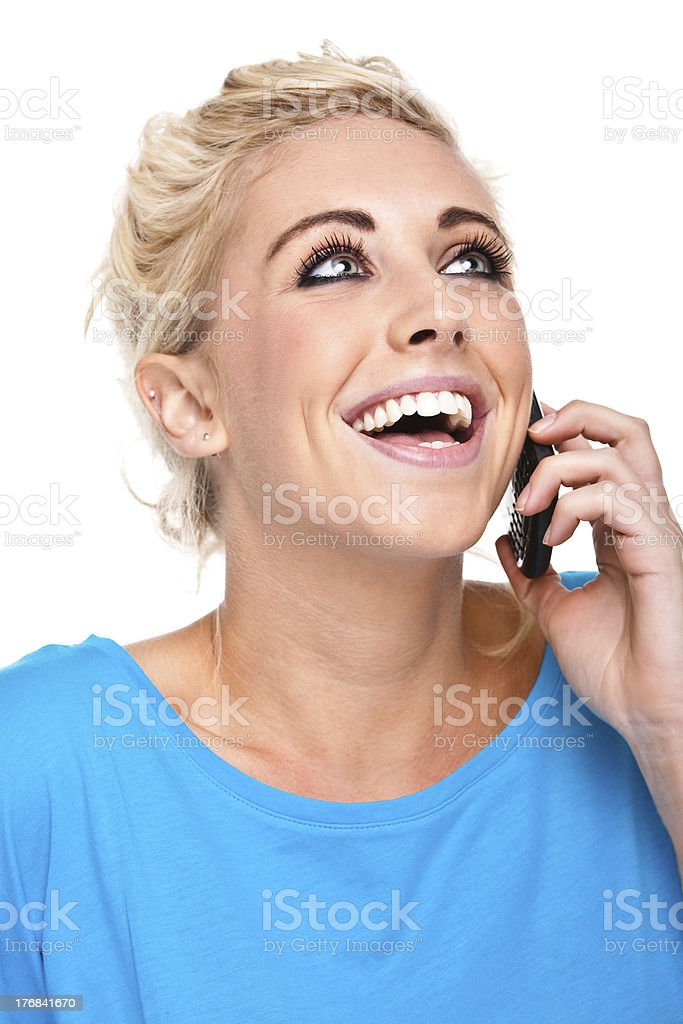 Close-up of Young Woman Laughing Speaking on Cell Phone royalty-free stock photo