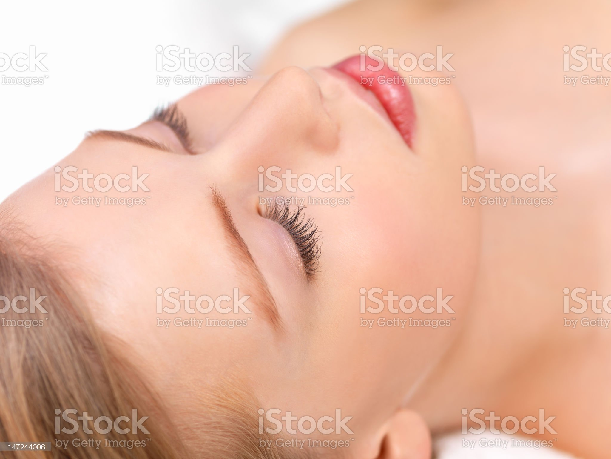 Close-up of young woman lying with eyes closed at spa royalty-free stock photo