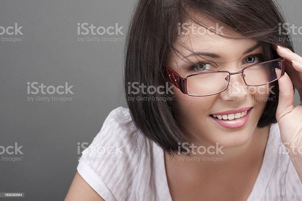 Close-up of young woman over gray background stock photo