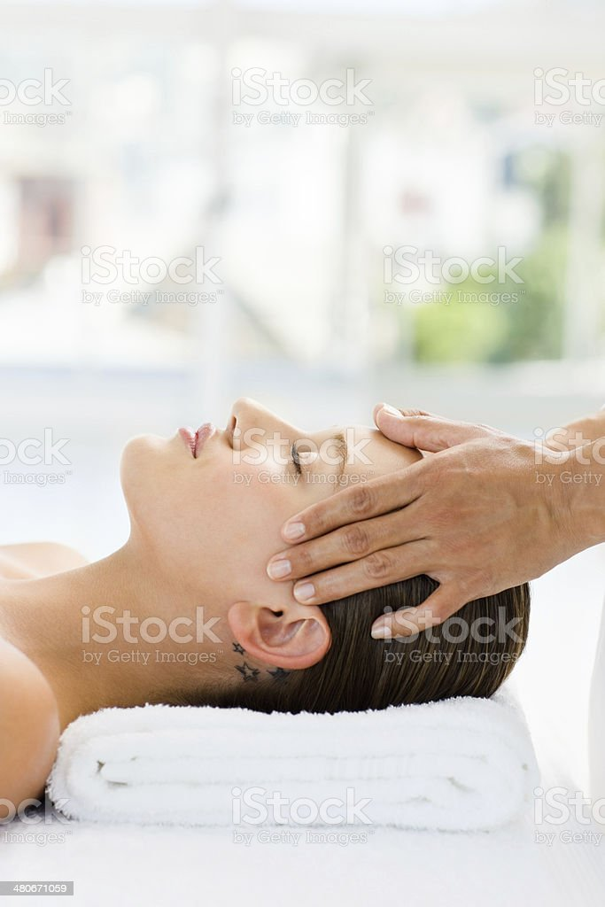 Closeup of young woman receiving head massage royalty-free stock photo