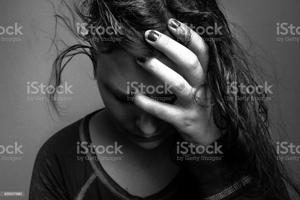 close-up of young woman sad, frustrated, somber, depressed, emotional stress stock photo