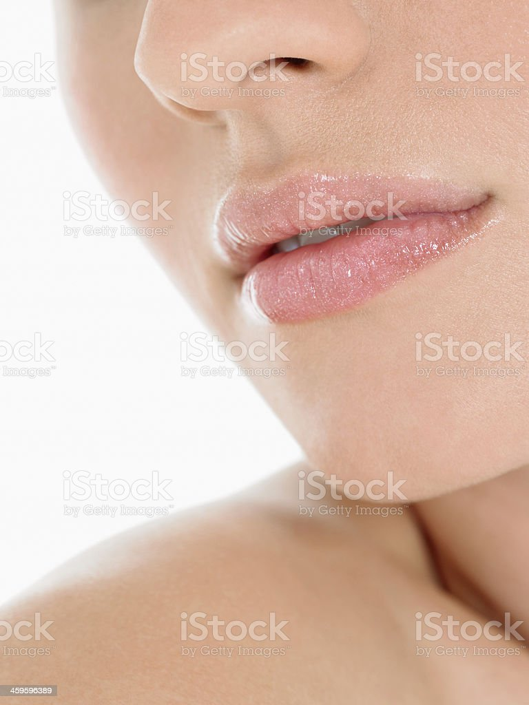 Closeup Of Young Woman Wearing Pink Lipstick stock photo