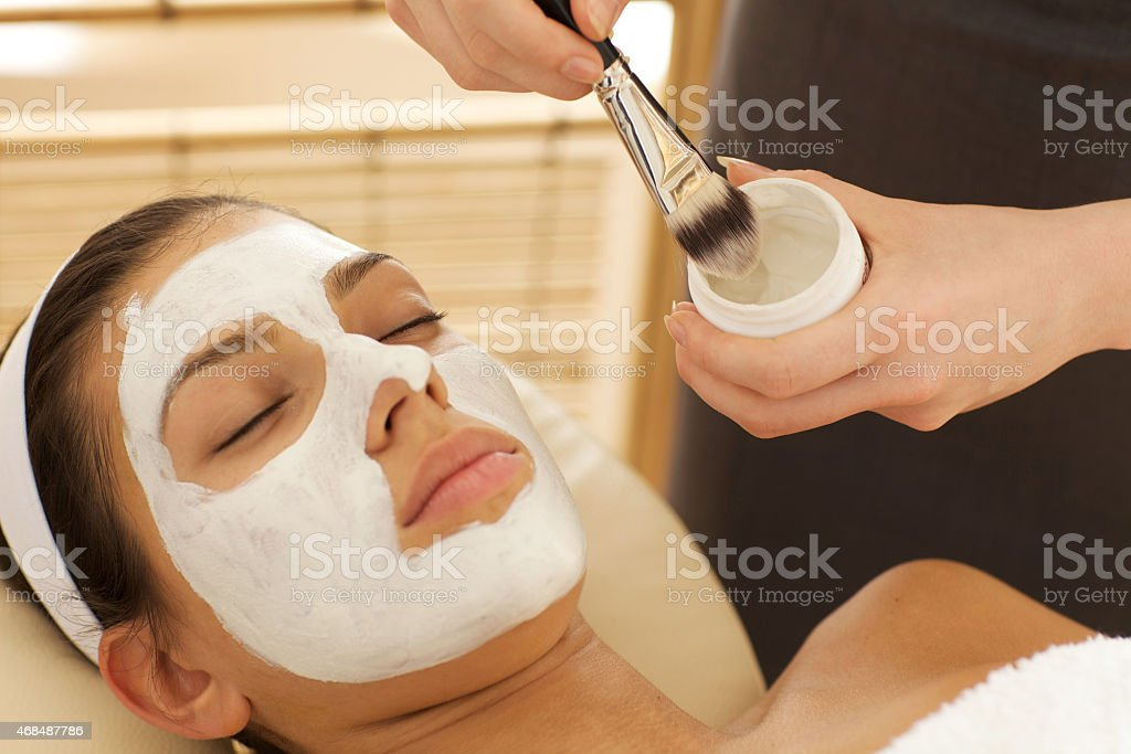Close-up of young woman with facial mask stock photo