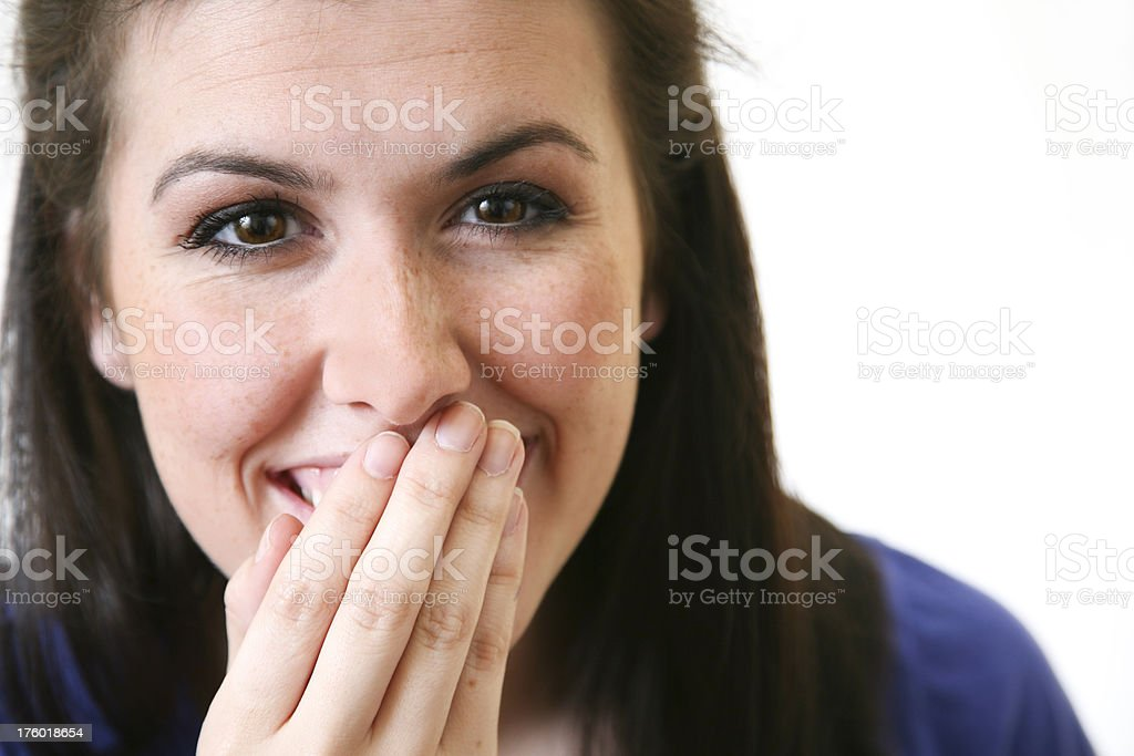 Closeup of Young Woman With Hand to Her Mouth royalty-free stock photo