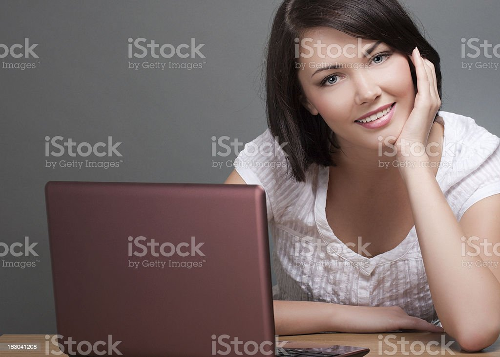 Close-up of young woman with laptop stock photo