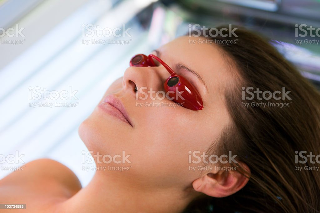 Close-up of young women in solarium stock photo