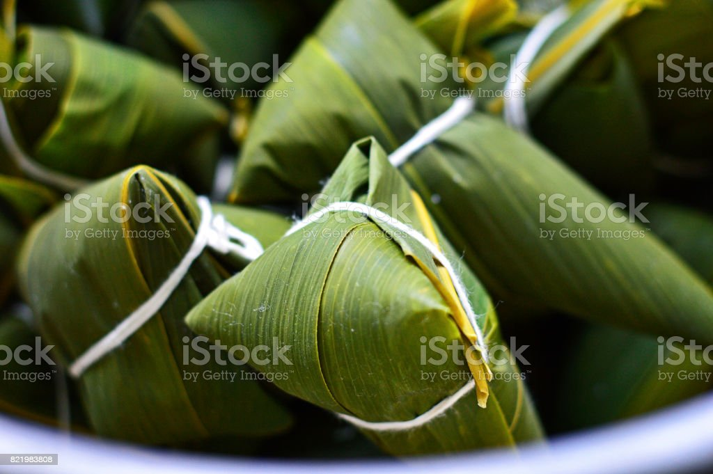 Close-Up of Zongzi, Traditional Chinese Rice Dumplings for Dragon Boat Festivals. stock photo