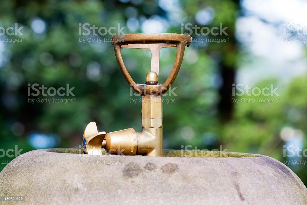 Closeup old brass drinking fountain in the park stock photo