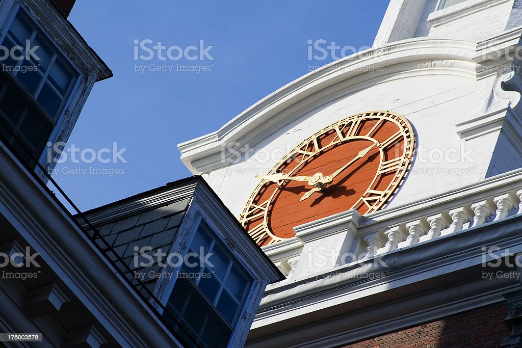 Close-up old White tower with red clock face stock photo
