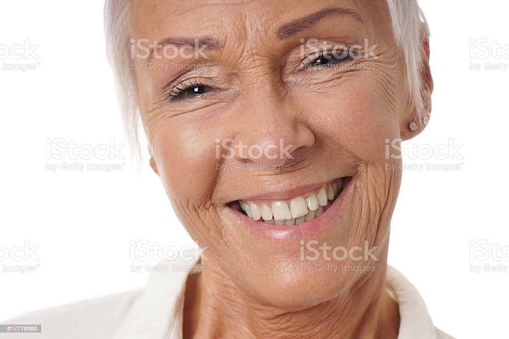 close-up older woman with toothy smile stock photo