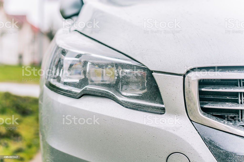 Close-up on a car headlight. Moder car exterrior. stock photo