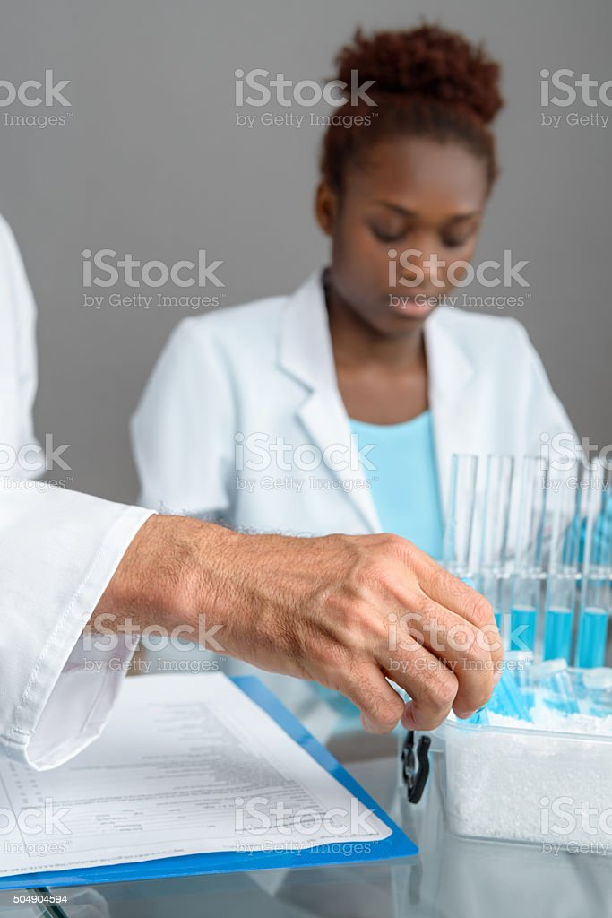 Closeup on a hand picking up scientific sample stock photo