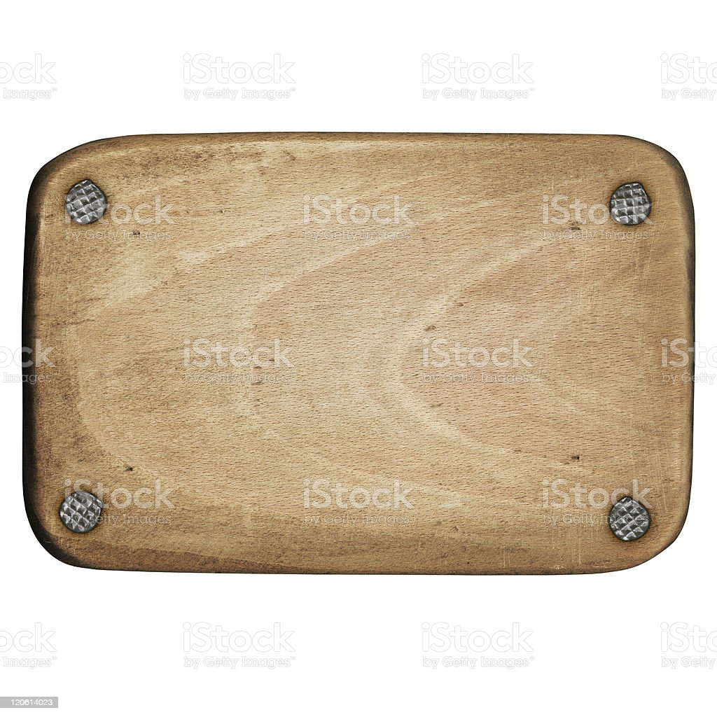 A close-up on a piece of wood with nails in each corner royalty-free stock photo