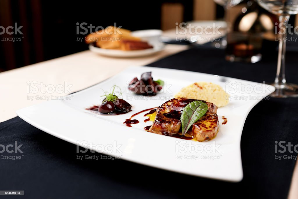 A close-up on a plate of foie gras stock photo