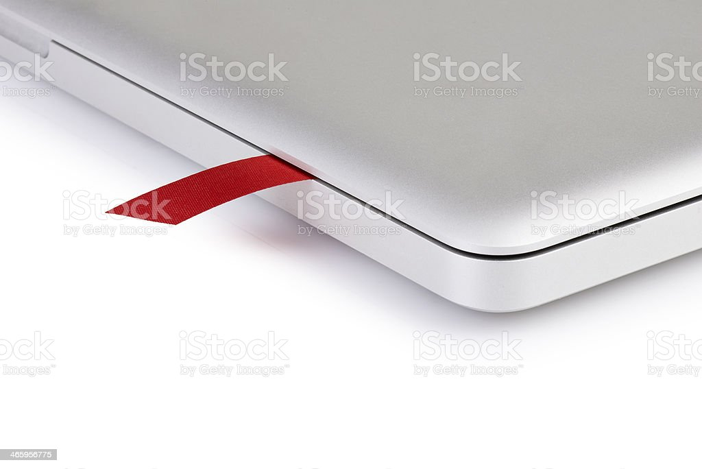 close-up on a red ribbon in  laptop stock photo