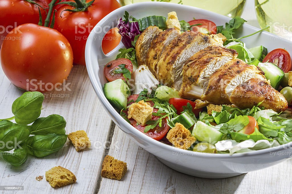 Close-up on a salad with chicken and tomato stock photo