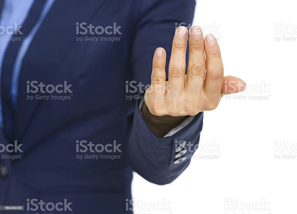 Closeup on business woman beckoning with hand stock photo