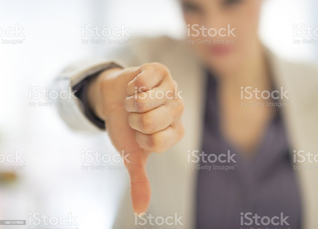 closeup on business woman showing thumbs down stock photo