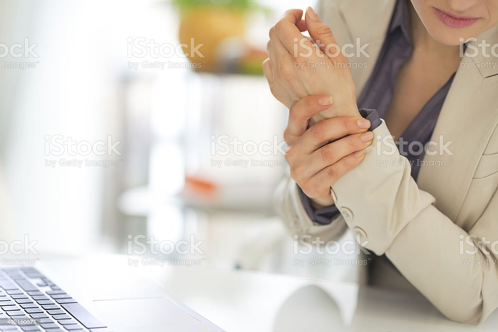 closeup on business woman with wrist pain stock photo