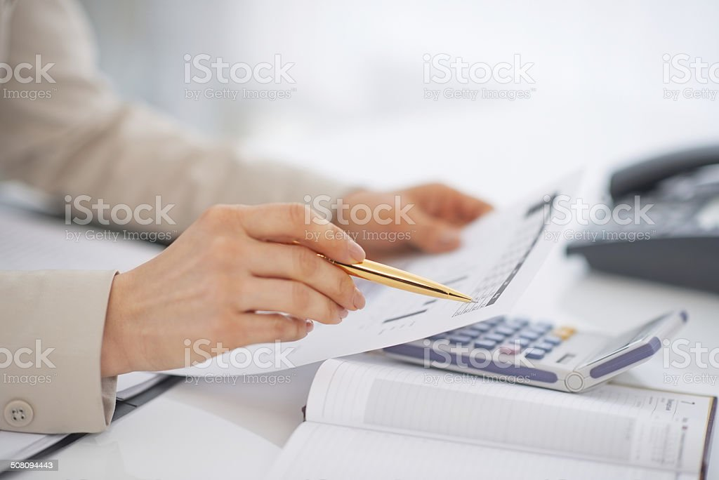 closeup on business woman working with documents stock photo