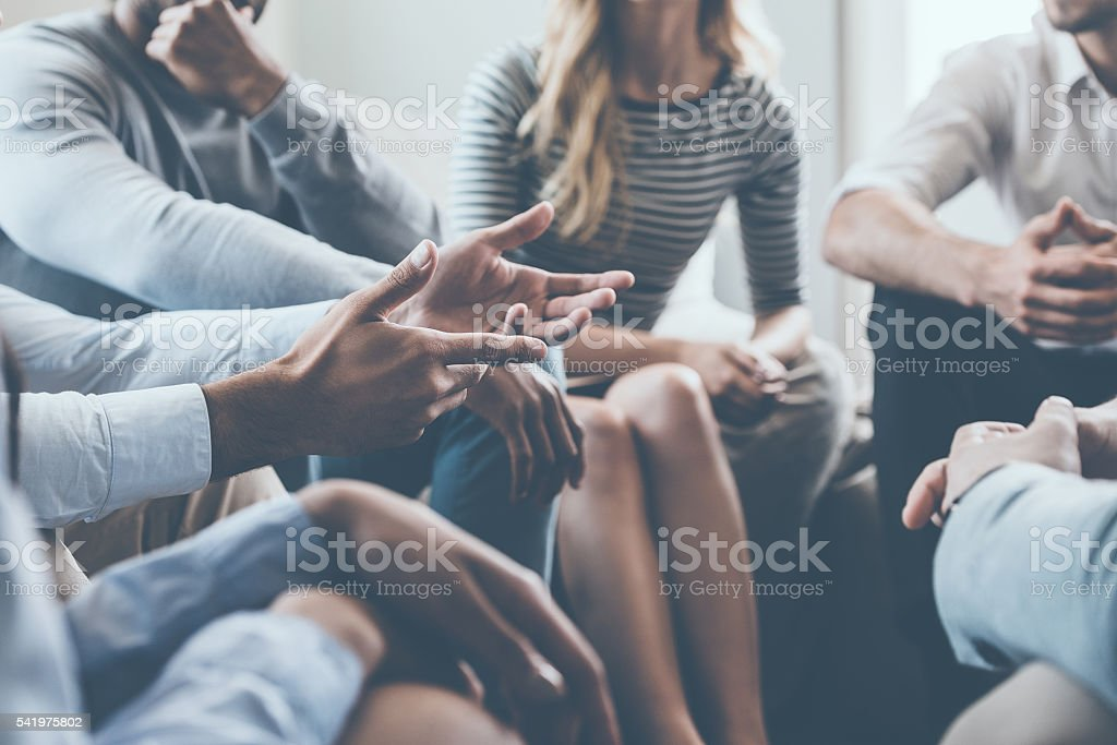 Close-up on discussion. stock photo