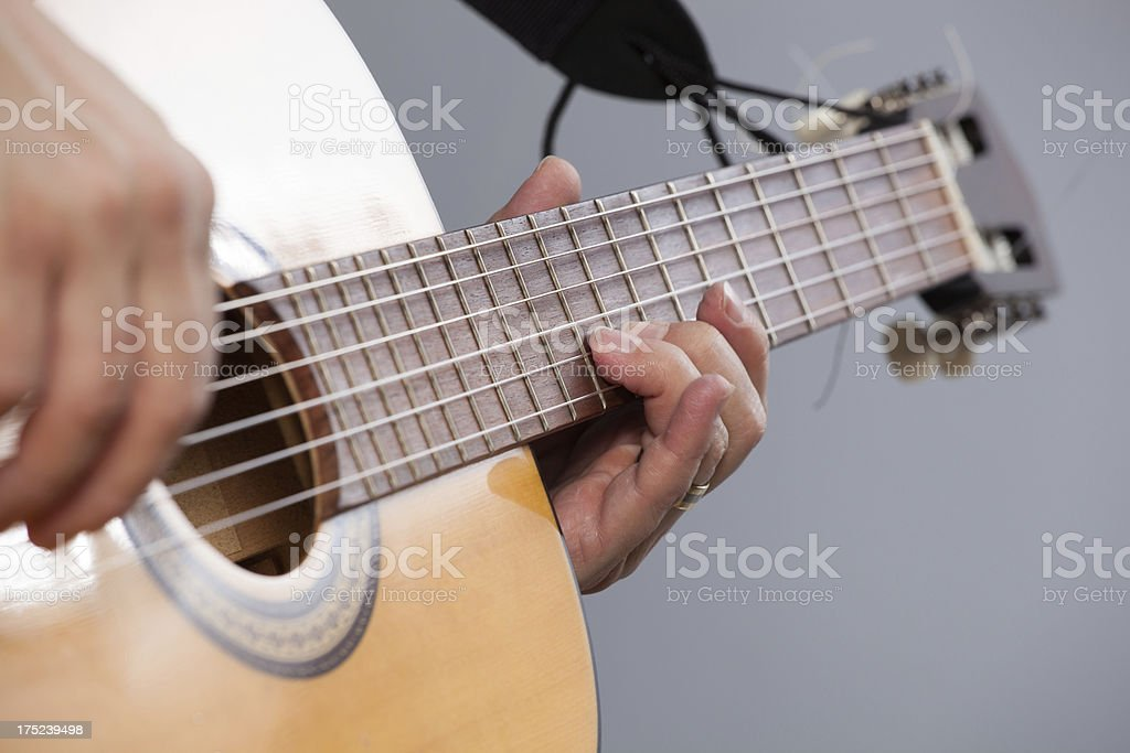 Close-up on guitar player royalty-free stock photo