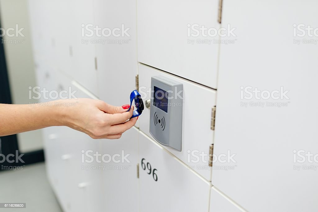 Closeup on hand opening change room locker stock photo