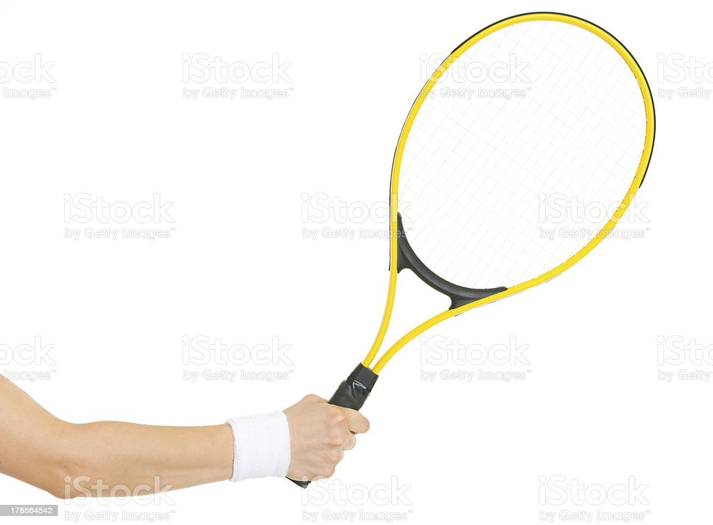 Closeup on hand with tennis racket stock photo