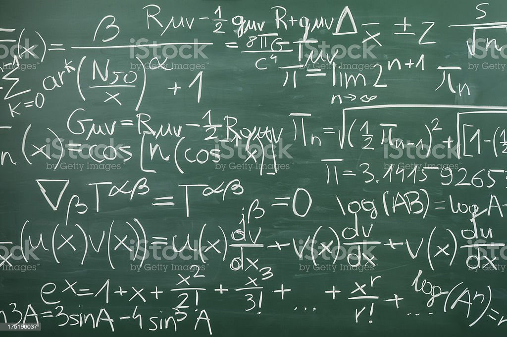 Close-up on hand written mixed mathematical formulas, blackboard stock photo
