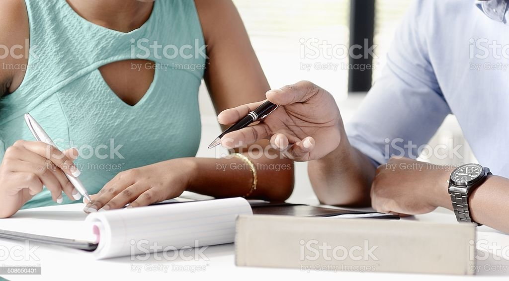 Close-up on hands of two colleagues meeting at work royalty-free stock photo