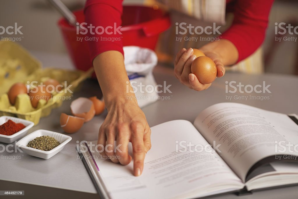 Closeup on happy housewife preparing christmas dinner in kitchen stock photo