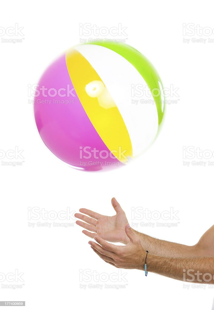 Closeup on males hand throwing beach ball up royalty-free stock photo
