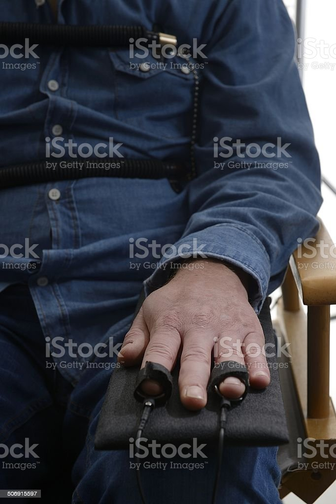 Close-up on polygraph finger sensors stock photo