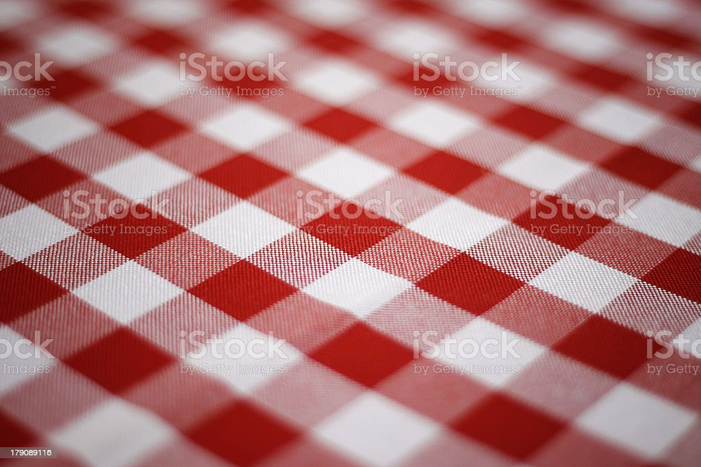 Close-up on red and white checked picnic blanket stock photo