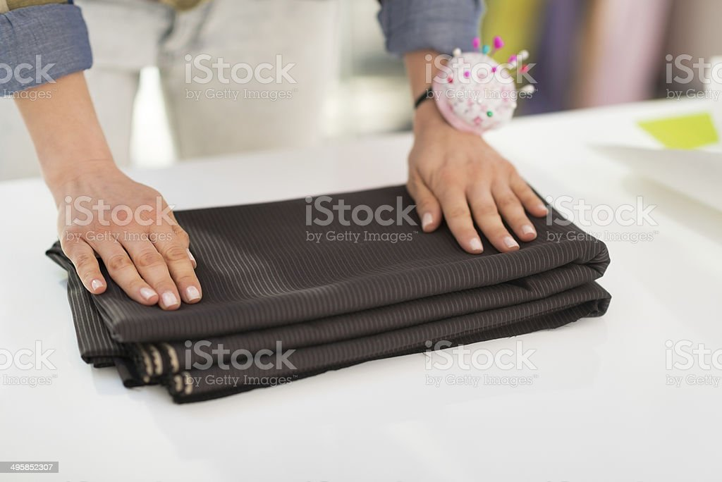 closeup on seamstress folding fabric royalty-free stock photo