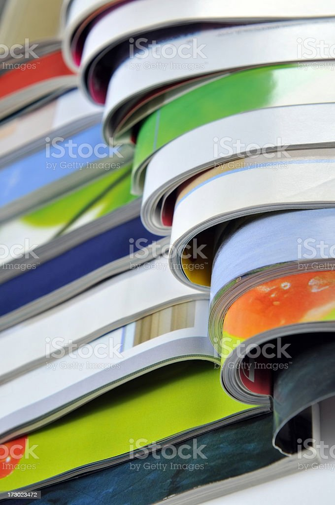 Close-up on stack of colourful open magazines royalty-free stock photo