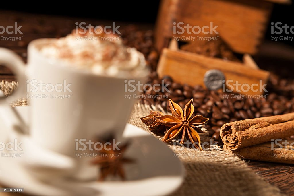 Close-up on star anise and cinnamon sticks with coffee cup stock photo