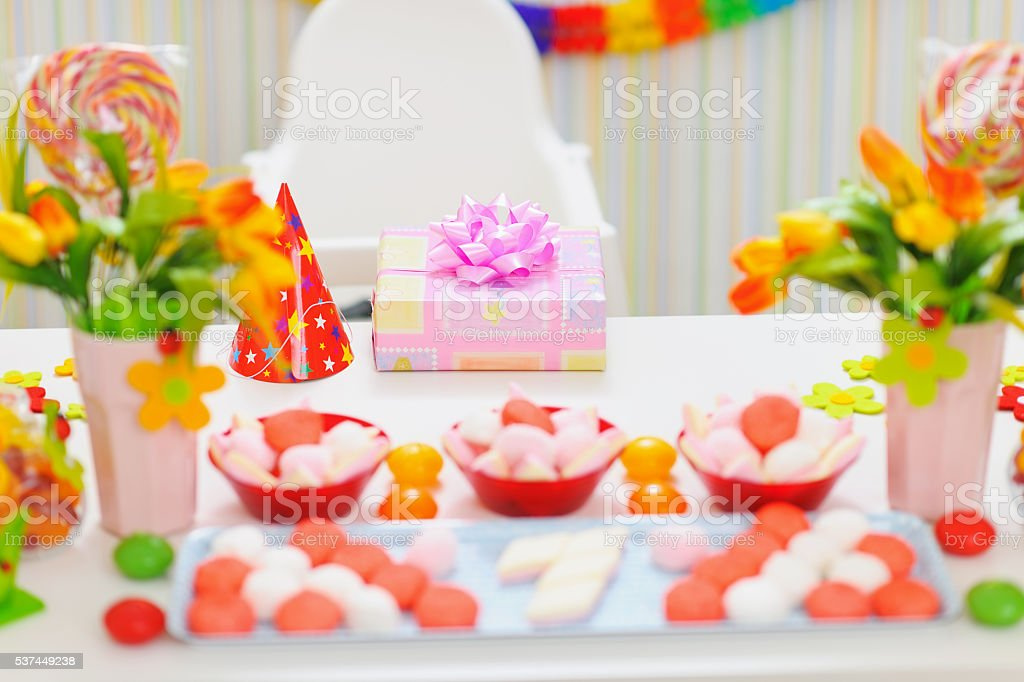 closeup on table decorated for baby birthday party stock photo