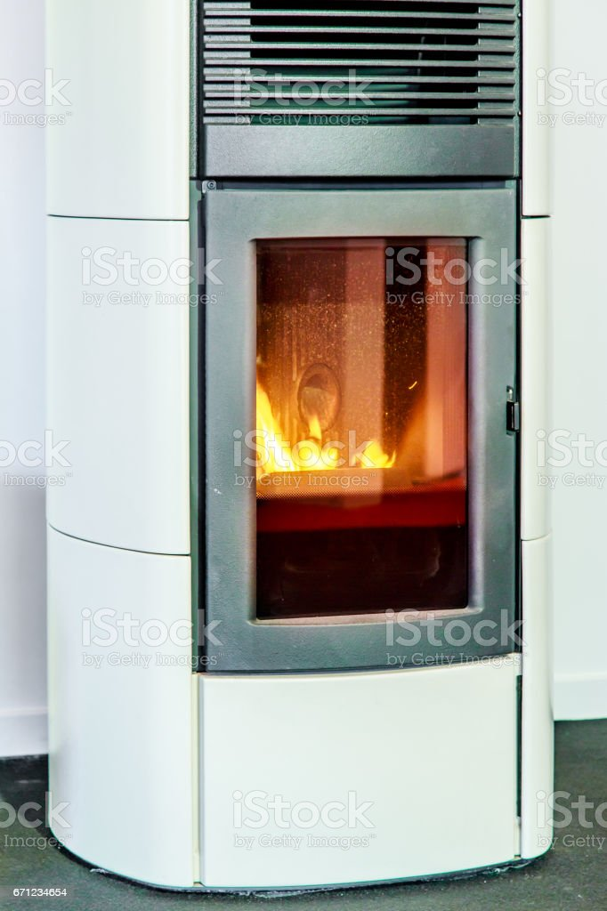 closeup on the combustion of an pellet stove stock photo