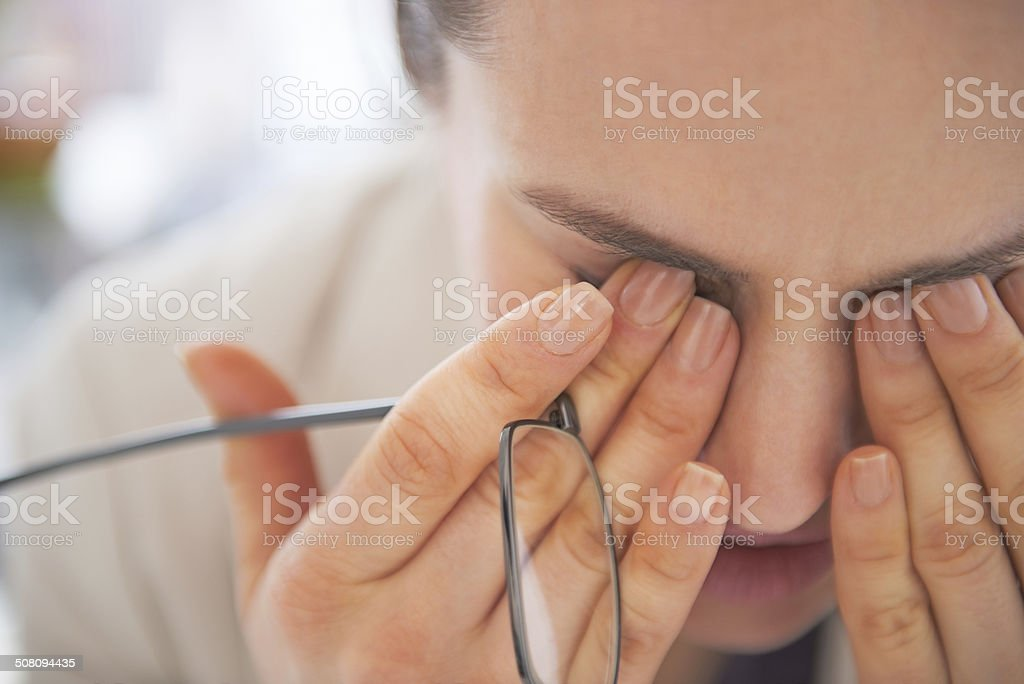 closeup on tired business woman with eyeglasses stock photo