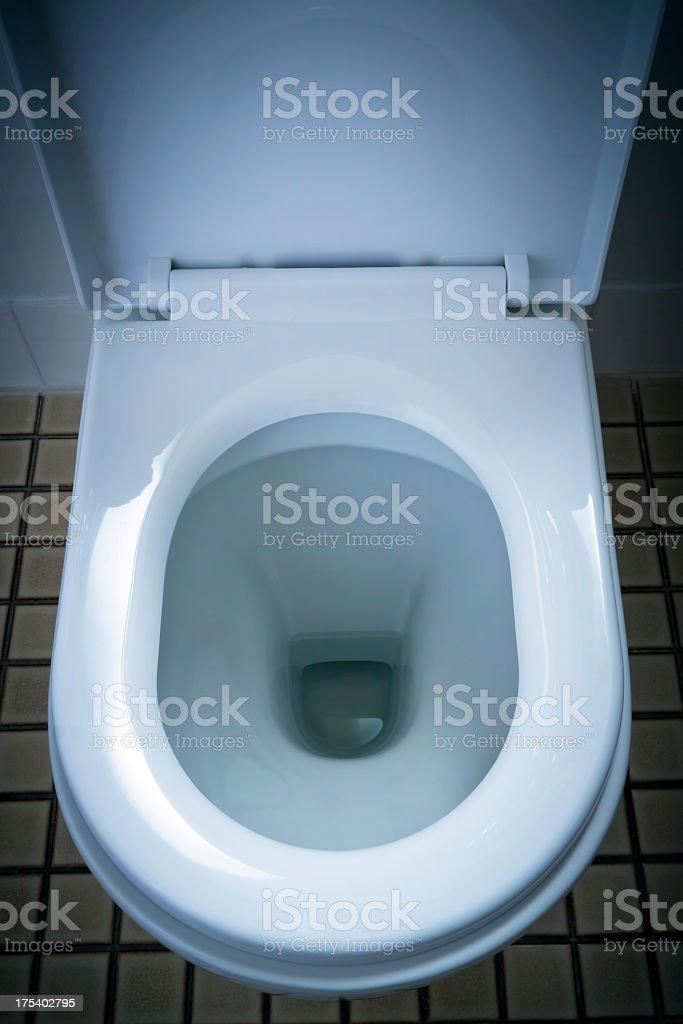 Closeup open household white porcelain toilet royalty-free stock photo